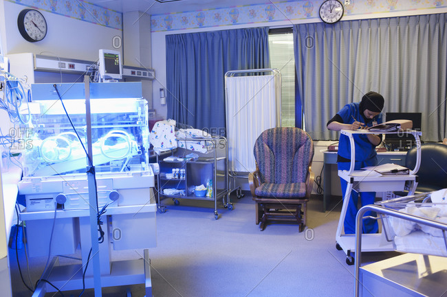 Nurse working in hospital nursery