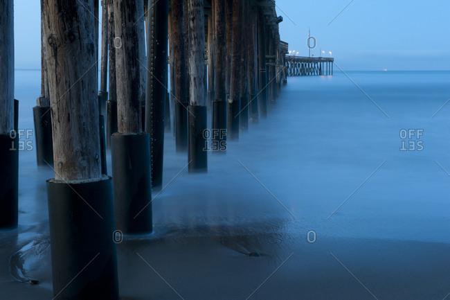 Ocean and dock pilings at beach