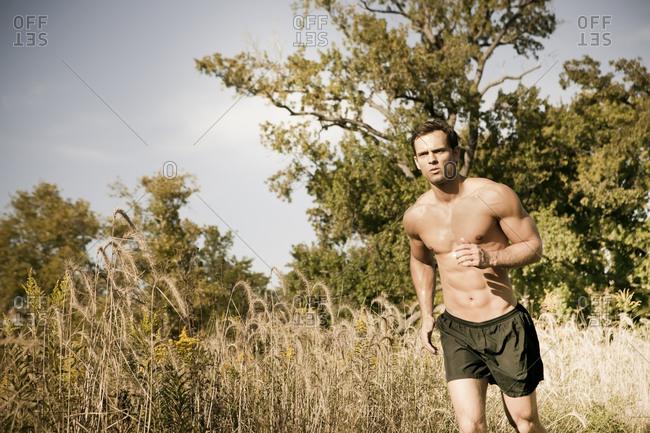 Caucasian man running outdoors - Offset