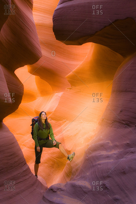 Woman hiking in canyon - Offset