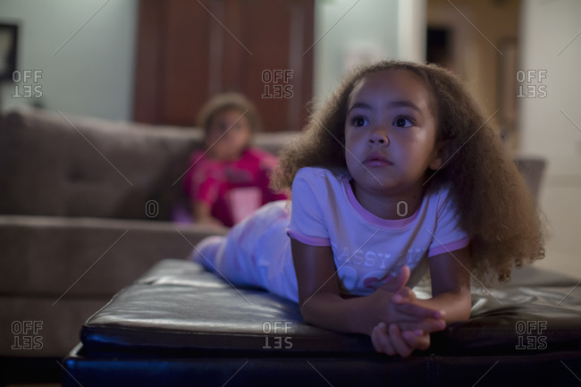 Mixed race girls watching television