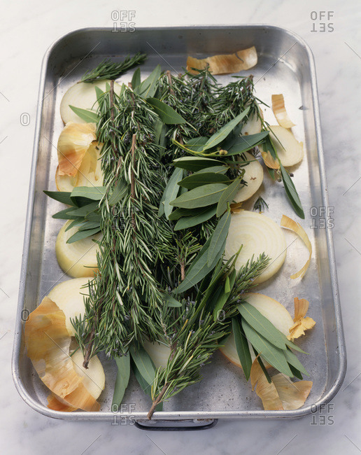 Close up of raw herbs and red onion