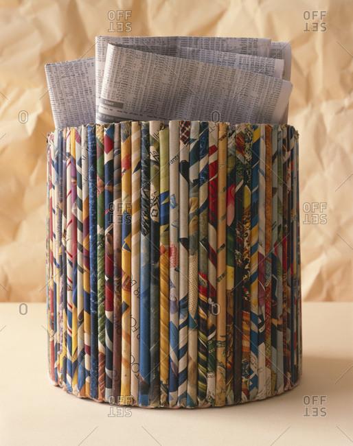 Close up of an old cylinder shape newspaper holder