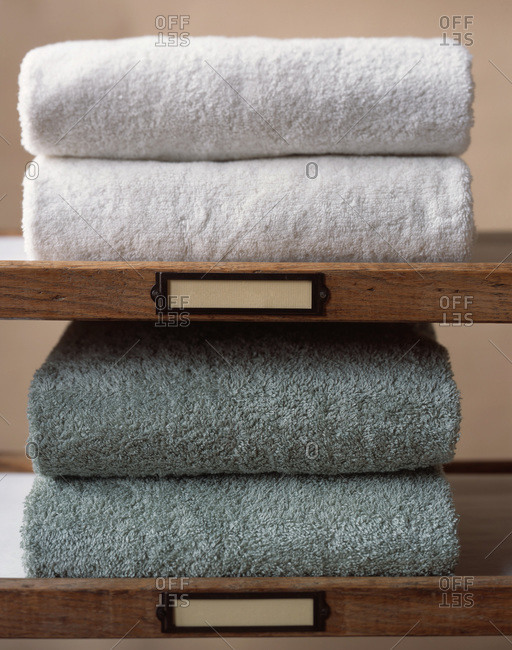 Close up of clean towels on shelves