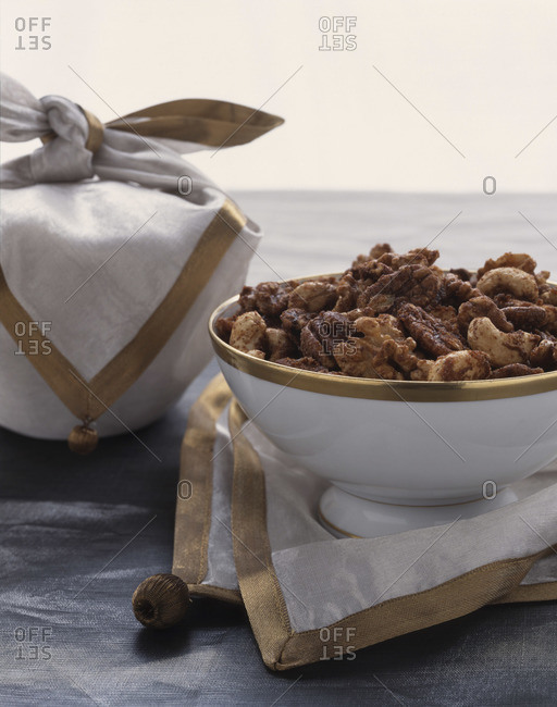 Close up of roasted and seasoned nuts served in a bowl