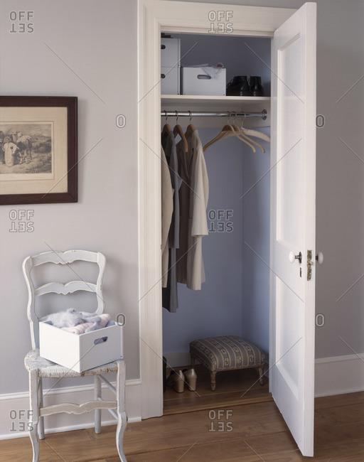 Half empty wardrobe in an old flat