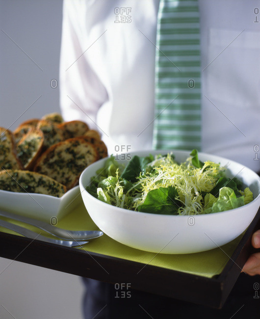 Close up of a businessman holding his lunch on a tray