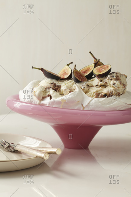 A homemade pavlova decorated with Fig and ice cream