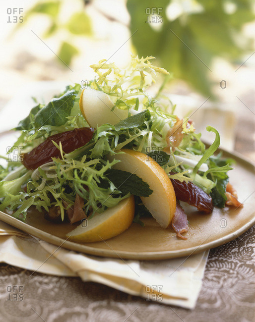 Mixed salad with frisee, asian pear, mint leaves and dried dates.