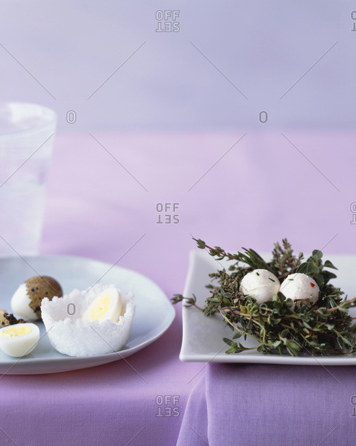 Nest from a bouquet garni and some boiled eggs on a white plate.