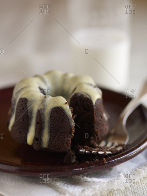 A small bundt cake on a plate.