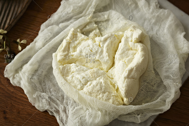 Homemade ricotta on cheesecloth.