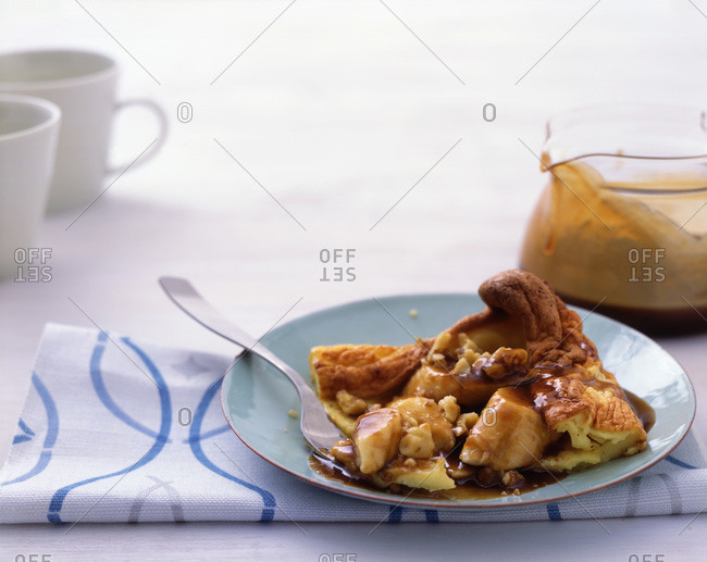 Plate of tempting banana pie with maple syrup