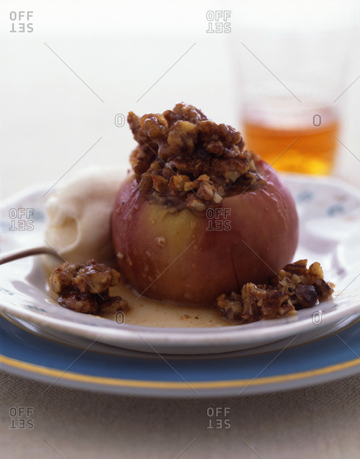 Stuffed and roasted apple with ice cream.