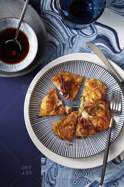 Rethought savory pancake with calamari.