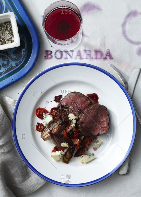 Roasted fillet mignon with red onion, cherry tomato and blue cheese.