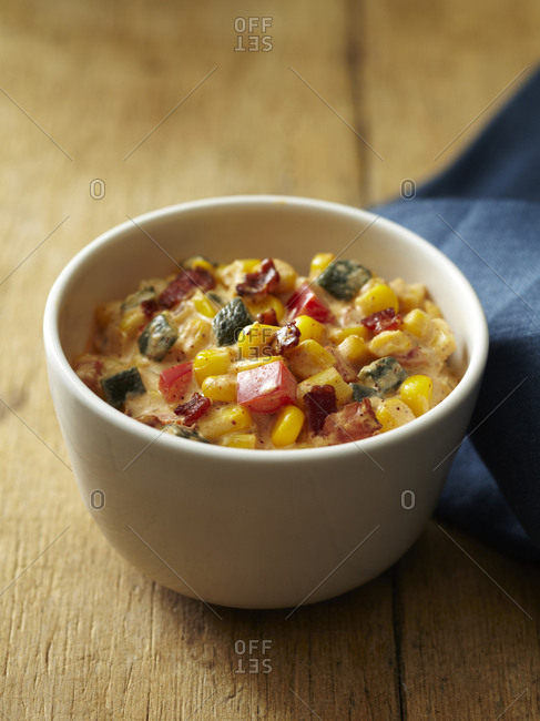Vegetable chowder in a white bowl.