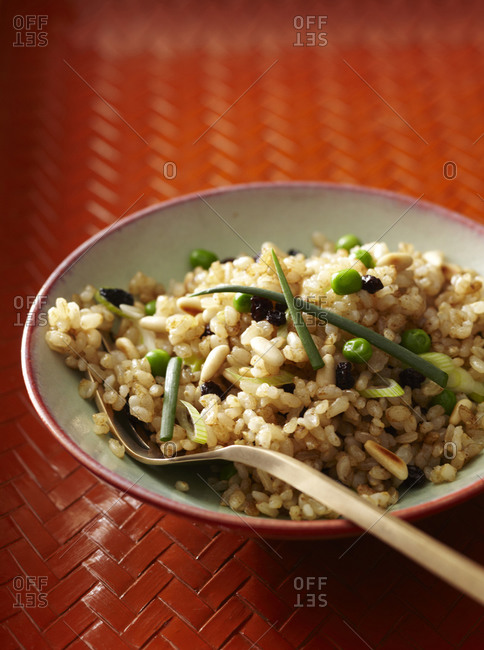 Barley with celery, peas, pine nuts, raisins and chives.