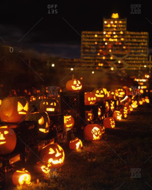Different illuminating jack-o'-lanterns at night.