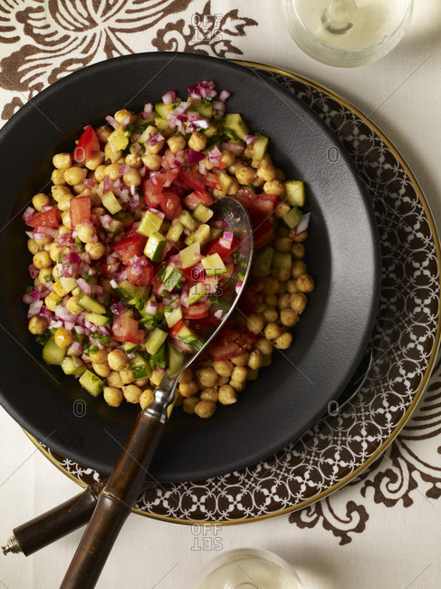 Chickpea with finely chopped tomato, cucumber red onion from above.