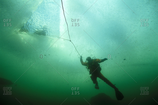 A person ice diving