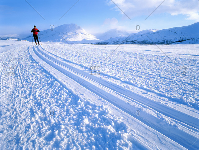 A long-distance skier in northern Sweden