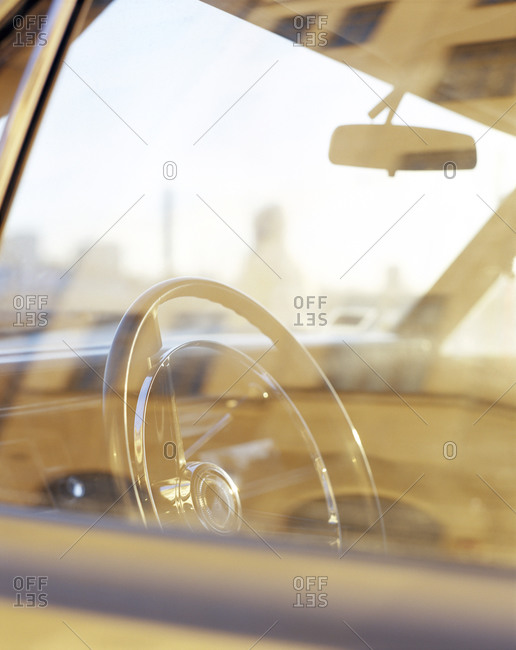 The interior of a car photographed through window of the car