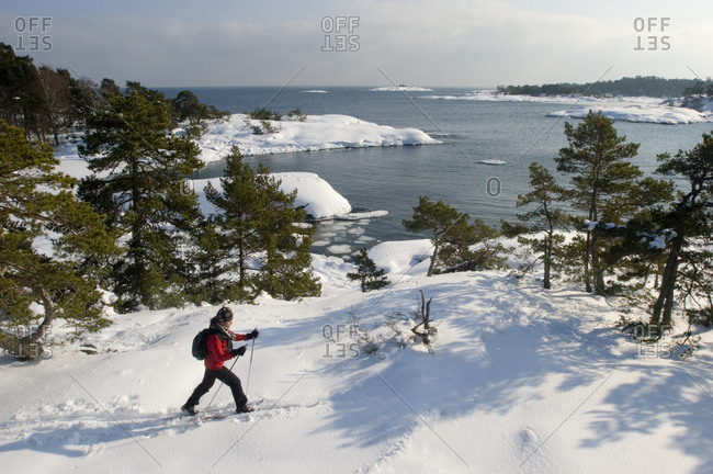 A person skiing in the archipelago of Stockholm, Sweden