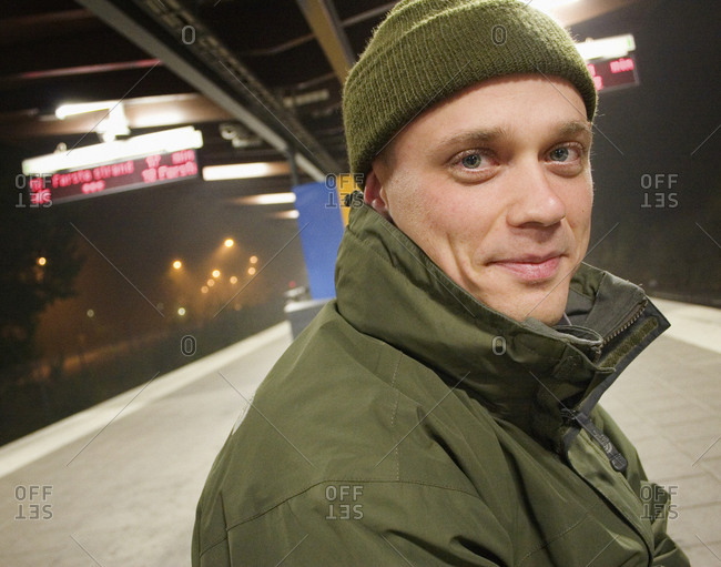 A man waiting for the underground in the evening, Sweden