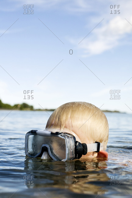 A boy swimming in a lake