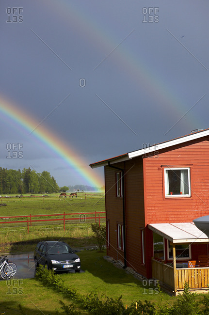 Rainbow over houses, Sweden
