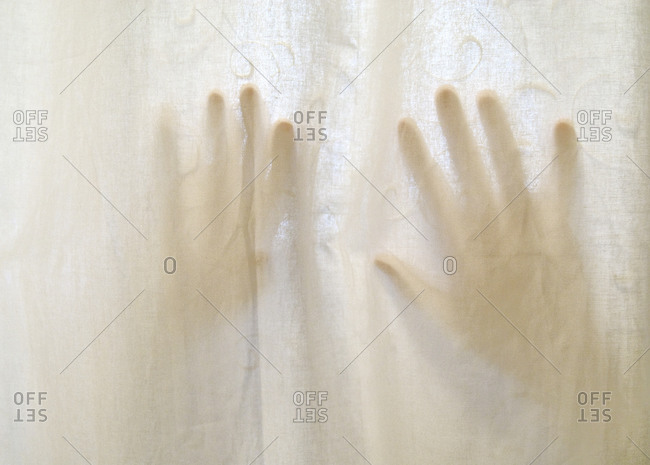 Hands on shower curtain