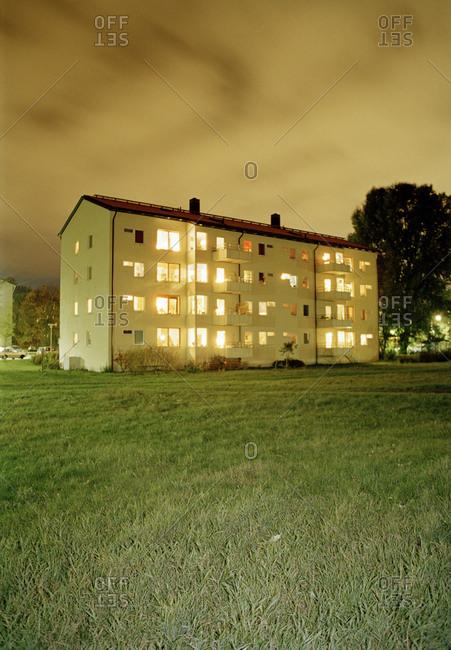 Illuminated apartment at dusk