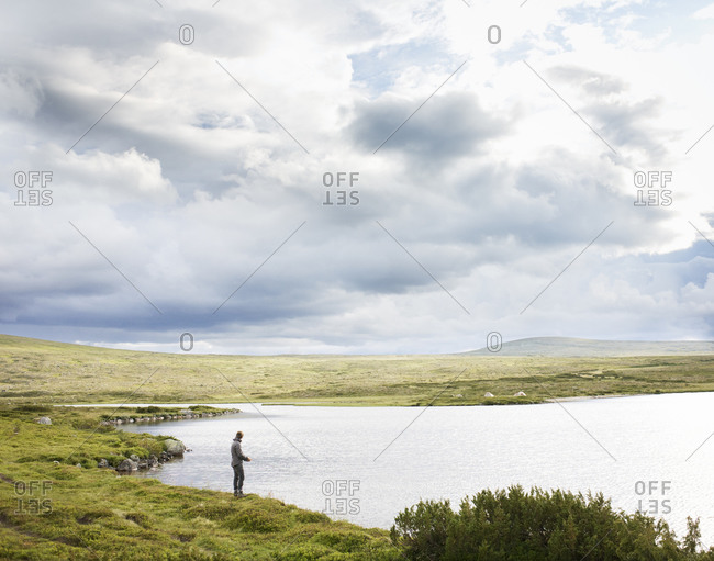 Man fishing at lakeside