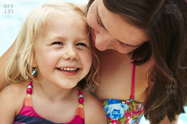 Portrait of mother with daughter in swimwear
