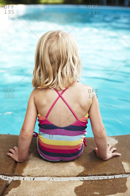 Back view of girl at poolside