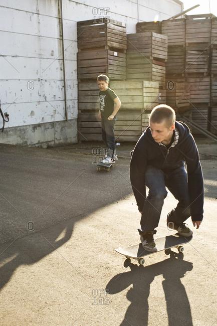 Teenagers on skateboards 10 12 years