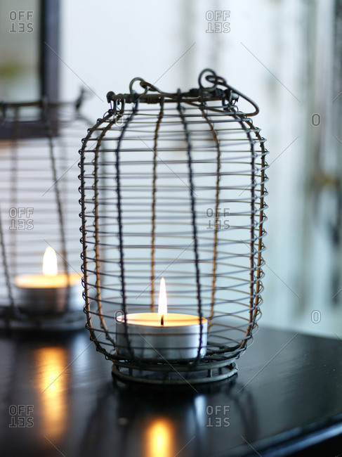 Close up of tea lights on table basket