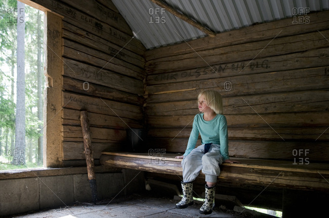 Girl sitting in cottage blonde