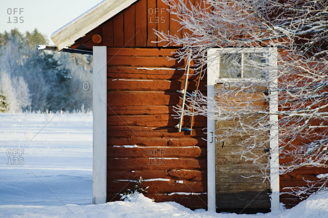 Wooden cabin in snow building