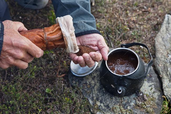 Tourist preparing coffee ability