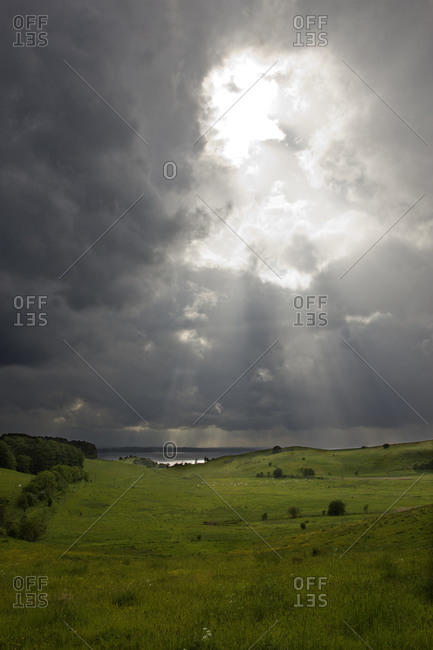 Sunbeams breaking through storm clouds bad weather