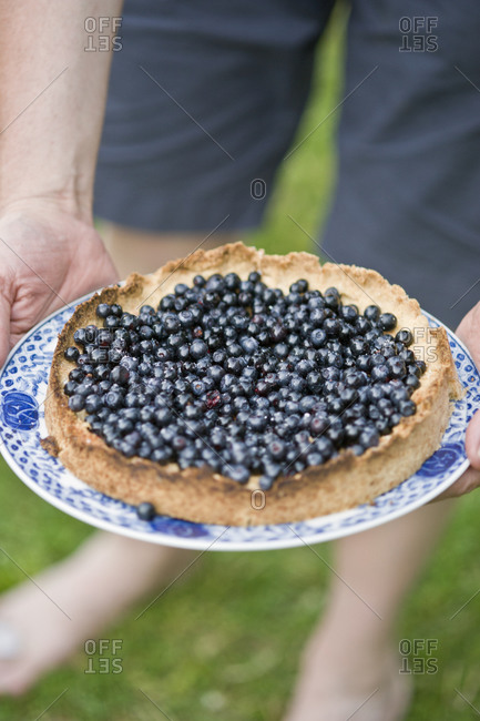 Man holding blueberry pie 45 49 years