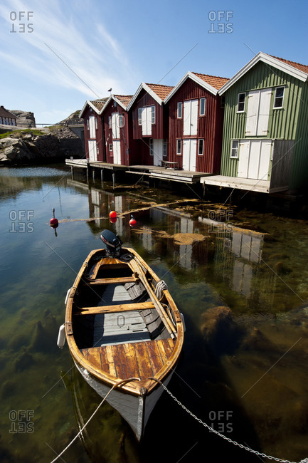 Fishing huts reflecting in harbor archipelago