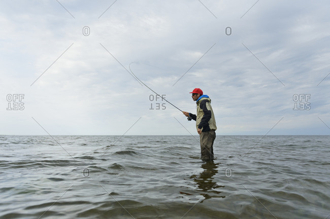 Man fly fishing in Baltic Sea activity