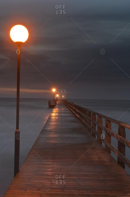 Empty jetty at dusk