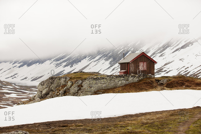 Wooden House in foggy mountains