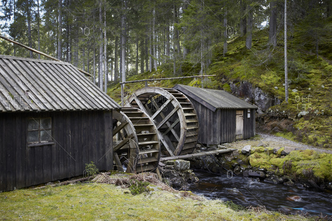 Old Wooden mill in forest architecture