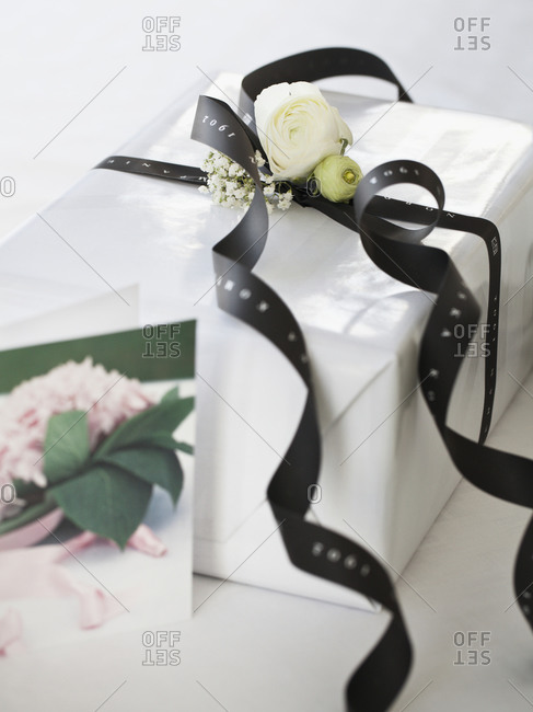 White gift box with black ribbon