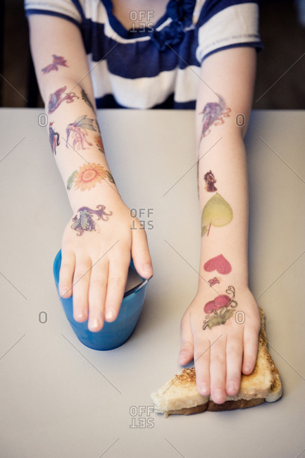 Fake tattoos on child's arms